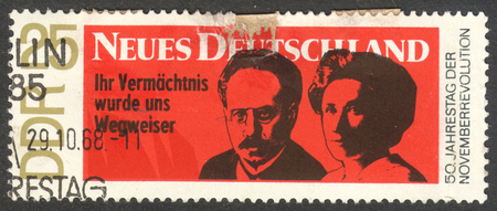MOSCOW RUSSIA - CIRCA OCTOBER 2017: a post stamp printed in DDR shows Karl Liebknecht and Rosa Luxemburg, the series The November Revolution, circa 1968