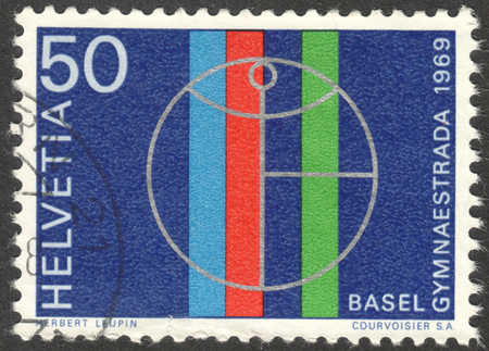 MOSCOW RUSSIA - CIRCA OCTOBER 2017: a post stamp printed in SWITZERLAND shows Gymnaestrada badge, circa 1969