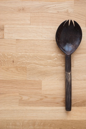 Coconut spoon on wooden background photo