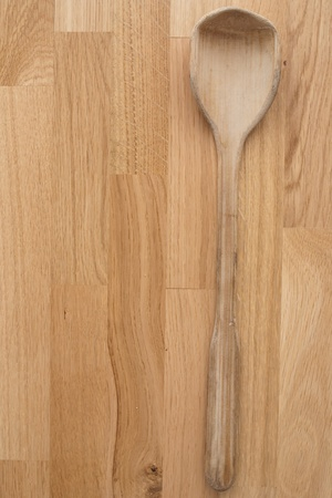 Wooden forg and spoon on wooden background photo