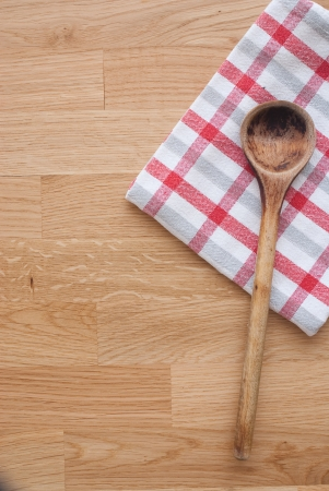 Wooden spoon and towel photo