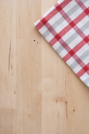 Wooden background and kitchen towel photo