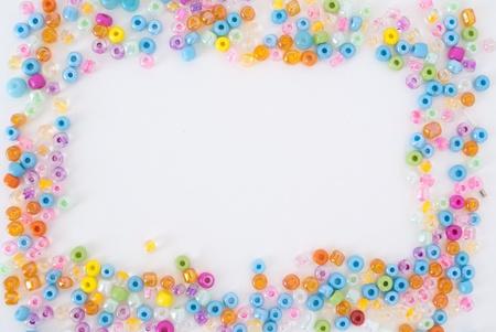 perls: Colored perls frame on white background