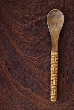 Wooden spoon on wooden background photo