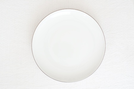 White plate on white paper background