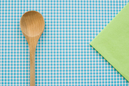 wooden spoon on colored background photo