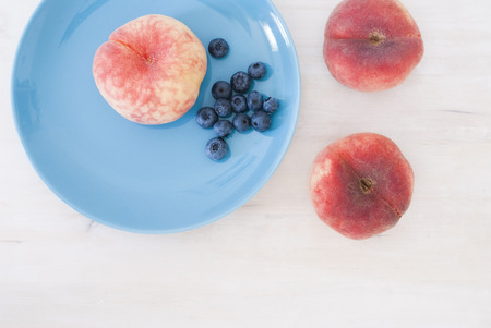 asian peaches and blueberry photo