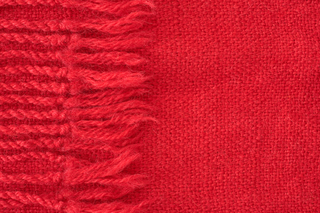 fringes: close up of red scarf - cashmere textile Stock Photo