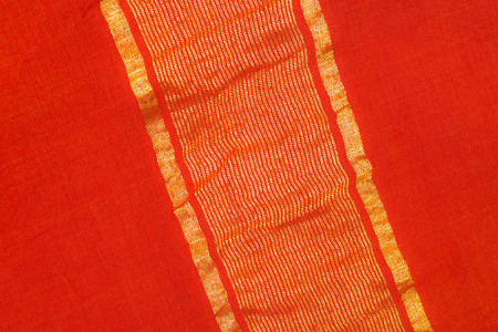 sari: close up of a sari - red silk textile with golden lines Stock Photo