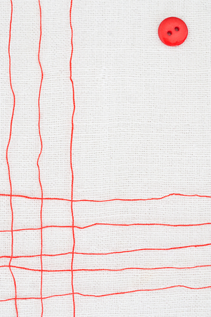 colored backgound: red thread on white textile background