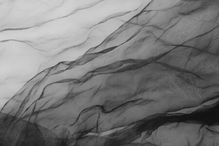 close up of black transparent tulle textile Standard-Bild