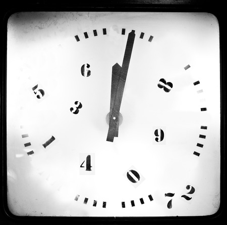 12 o clock: classic round clock isolated on textured background