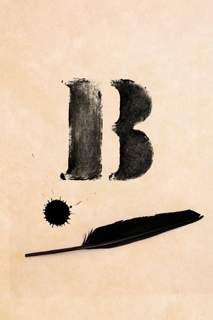 frayed: Old black, frayed grunge B - letter, inkblot and black feather on brown paper Stock Photo