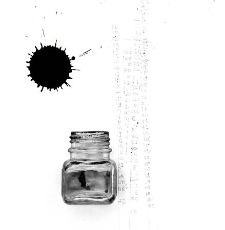 inkblot: ink pot, letters and black inkblot on white paper