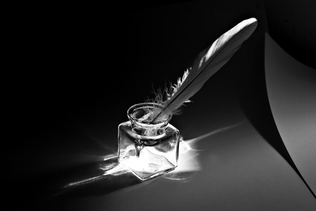 feather and ink pot black and white