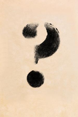 frayed: Old black, frayed grunge question mark on brown paper