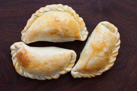 fresh empanada - traditional food  on wooden background