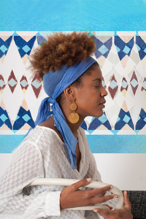 ojos cerrados: young afro american woman profile with closed eyes - studio shot -  design background Foto de archivo