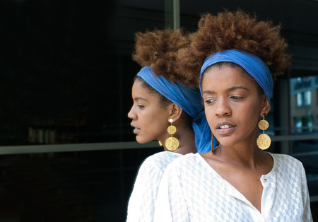 young afro american woman in a mirror