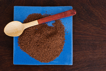 chocolate powder: chocolate powder and wooden spoon Stock Photo