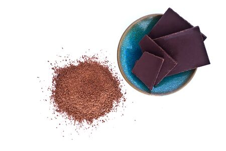 chocolate powder: chocolate powder and chocolate on a plate Stock Photo
