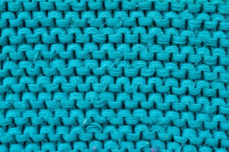 craft background: close up of woolen texture - textile background