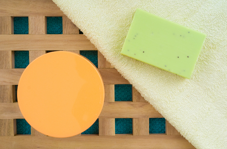 glycerin soap: green soap on a textured wooden background