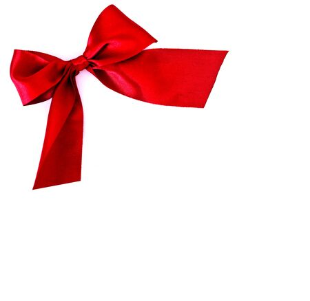 festive red bow on white background - copy space for text