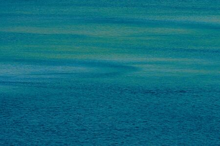 sun drop: blue water surface - abstract background Stock Photo