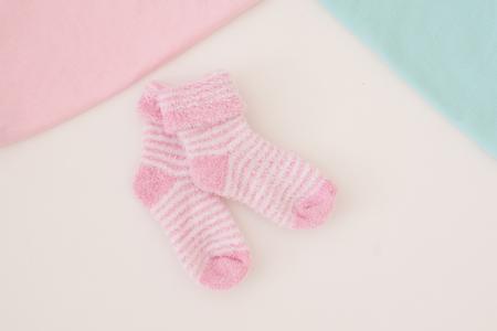 girl in towel: little baby socks on white background - studio shot