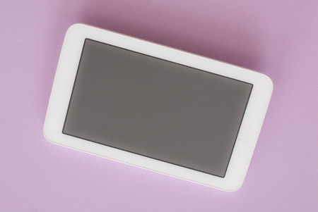 femenine: Modern white tablet pc isolated on pink background with clipping path