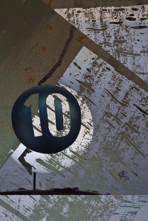 numero diez: grunge retro number ten on textured background