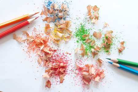 sharpenings: colorful pencil sharpener  and colorful pencils on white background Stock Photo