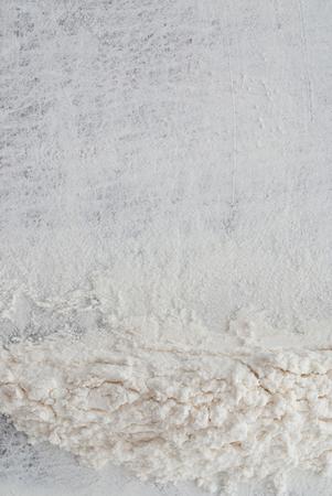 white flour: close up of white flour on wooden background
