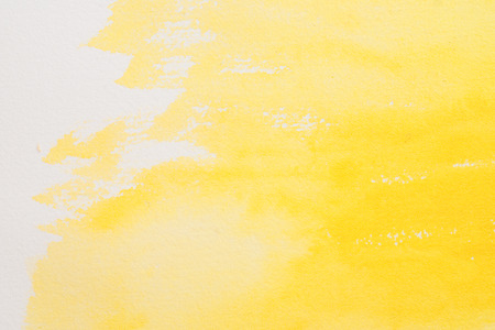 citron: yellow watercolors on textured paper surface - design element - abstract background trend color citron fizz Stock Photo