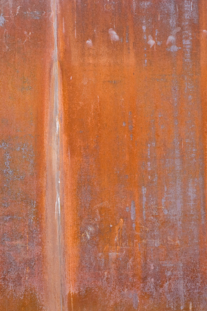 oxidized: oxidized material - close up of a textured oxidized surface background design - orange and copper