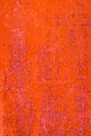 oxidized: oxidized material - close up of a textured oxidized surface background design - intense red