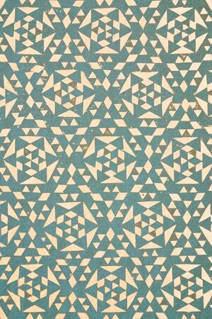 �rabe: close up of turquoise tradtional design printed on textured cotton - abstract fashion background