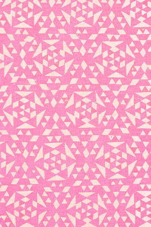 �rabe: close up of pink tradtional design printed on textured cotton - abstract fashion background Foto de archivo