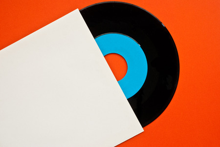 cd label: one long play vinyl records and cover - free space for text - orange background Stock Photo