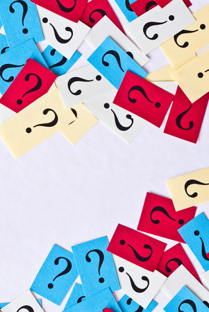 FAQ - Question marks on white paper background Stock Photo
