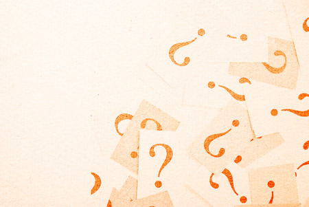 FAQ - Question marks on beige paper background