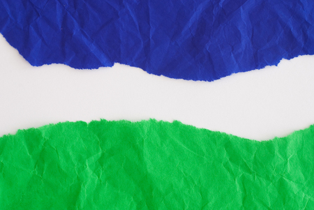 blue and green paper on white surface - design background Stock Photo