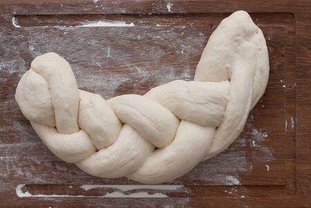 artisanal: Challah bread on wooden background