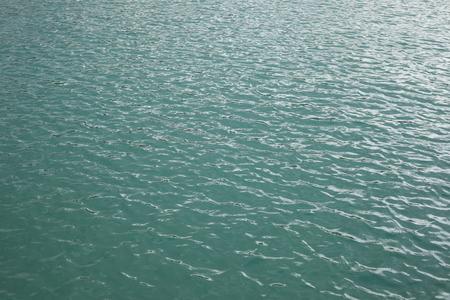 Superficie del agua azul - cerca de la textura del agua Foto de archivo - 80325758