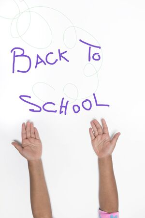keep in touch: Child hands and rainbow colors - education concept Back To School Stock Photo