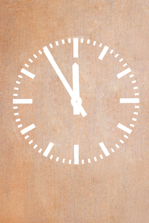 Classic clock on grunge wallpaper