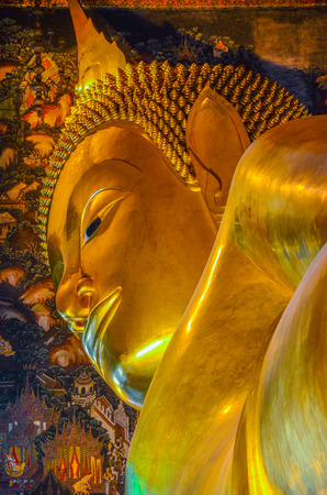 Closed up reclining Buddha Image at Wat Pho, Bangkok, Thailand. Generally, in Thailand, any kind of art decorated in Buddhist church, temple, pavilion, temple hall, monk�s house etc., created with money donated by people to hire artist. They are pu
