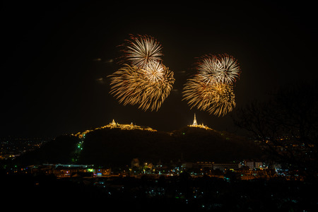Fireworks at Kao Wang mountain, over the cityscape of Petchburi, Thailand