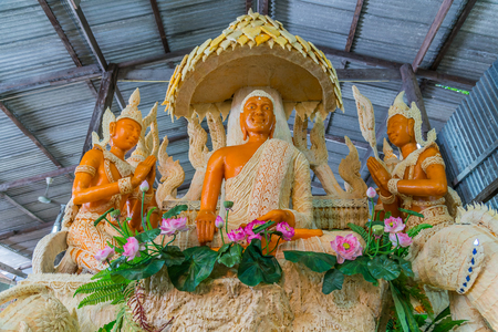 goddesses: Buddha image with Thai literature goddesses made from wax for marching in candle festival in Ubonratchthani, Thailand